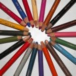 Pastel pencils arranged in a circle