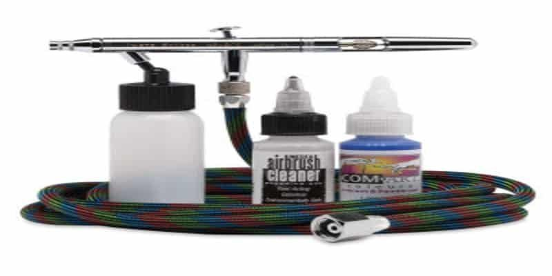 Airbrush with hose, cleaner, paint and paint bottle