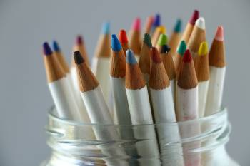 Assorted colored pencils in a jar